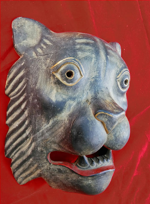 Carved wood lion mask from Asia